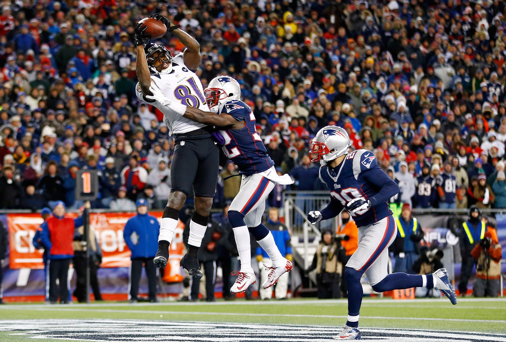 Description of . Anquan Boldin #81 of the Baltimore Ravens scores a touchdown passed by Joe Flacco #5 in the fourth quarter against Devin McCourty #32 of the New England Patriots during the 2013 AFC Championship game at Gillette Stadium on January 20, 2013 in Foxboro, Massachusetts.  (Photo by Jared Wickerham/Getty Images)