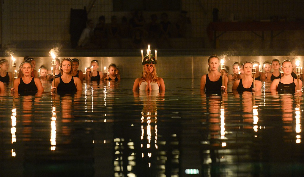 . Children and teenagers from the Neptun synchronised swimming club perform during a Saint Lucia concert at the Forsgrenska pool on December 12, 2014 in Stockholm. JONATHAN NACKSTRAND/AFP/Getty Images