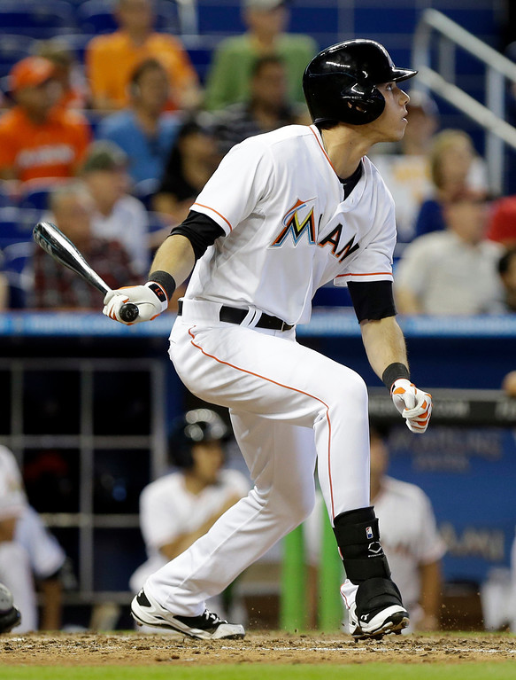 . Miami Marlins\' Christian Yelich watches after hitting a single to score Adeiny Hechavarria for the tying run in the eighth inning of a baseball game against the Colorado Rockies, Thursday, April 3, 2014, in Miami. The Marlins defeated the Rockies 8-5. (AP Photo/Lynne Sladky)
