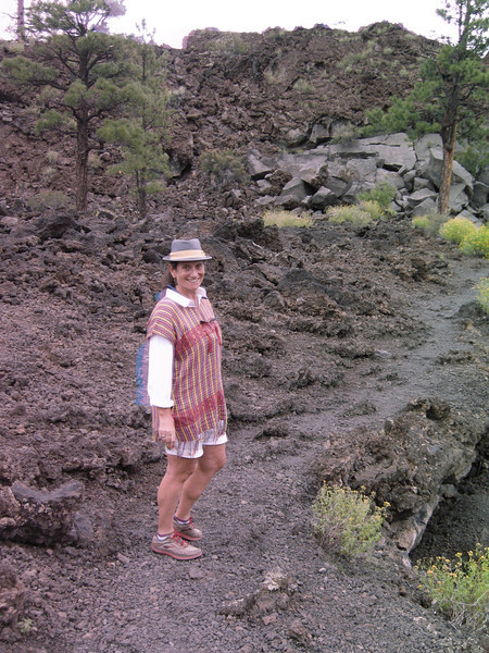 """A trail among the lava. Note the """"ghost"""" on Michèle's arm, a hint that the camera was about to freak out as it had on our High Sierra hike a month or so prior."""