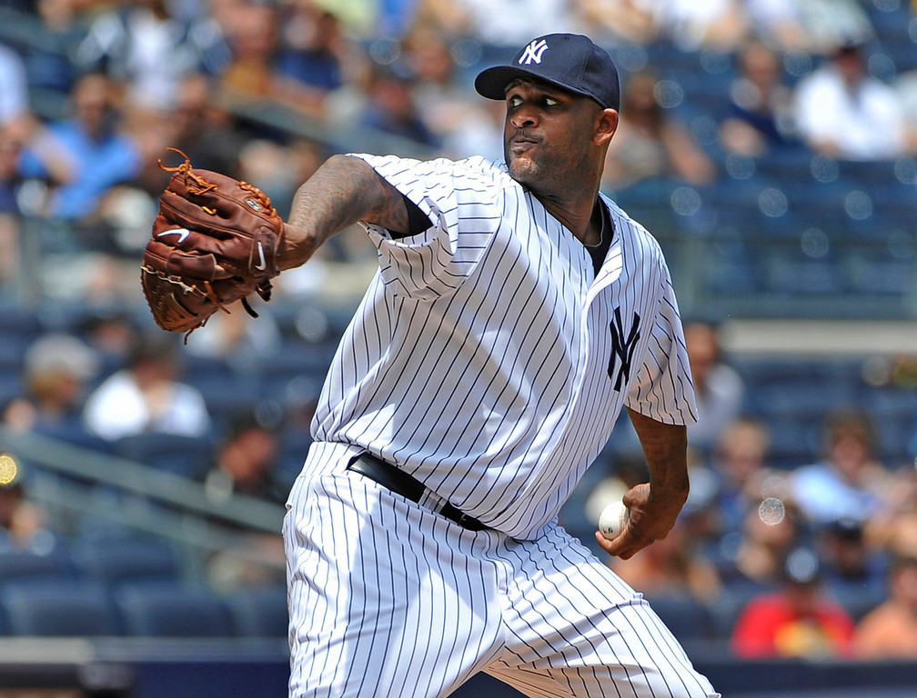 . Yankees starting pitcher C.C. Sabathia throws against the Twins in the second inning. (AP Photo/Kathy Kmonicek)