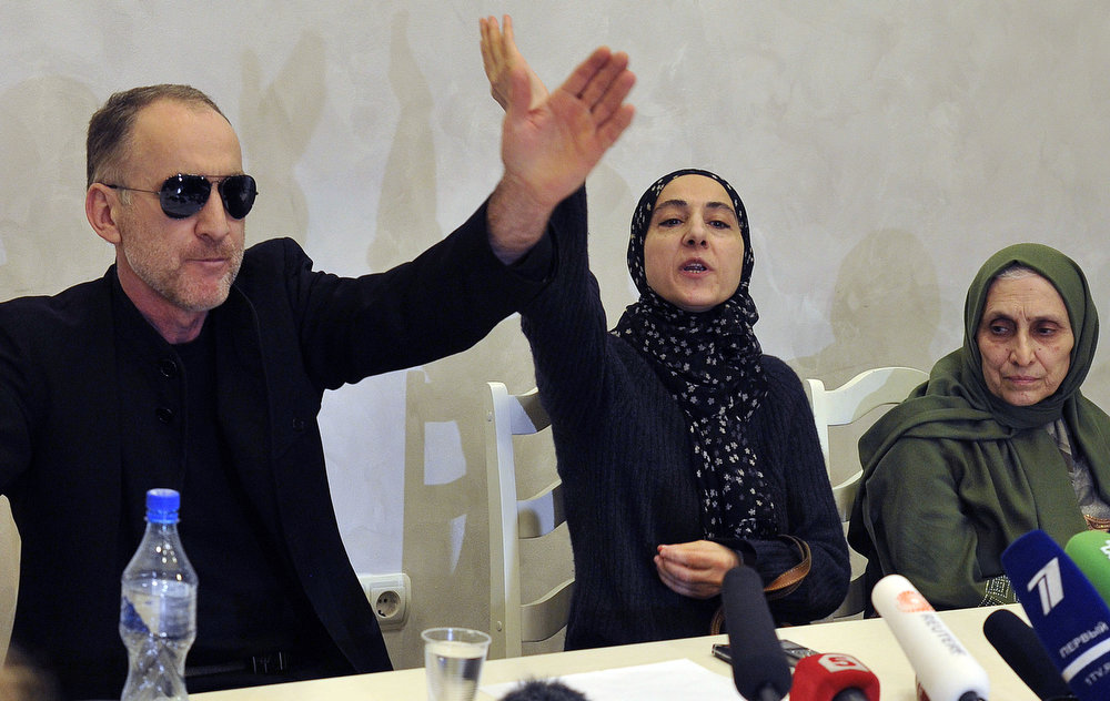 . Anzor Tsarnaev, father of the suspected Boston bombers, brothers Tamerlan and Dzhokhar Tsarnayev, speaks with journalists as a mother Zubeidat Tsarnaeva (C) and their aunt Patimat Suleymanova (R) attend a news conference in Makhachkala on April 25, 2013. The mother of the two brothers suspected of carrying out the Boston bombings on Thursday launched an impassioned attack on the US authorities over the death of one of her sons, as her husband planned to return to the United States to find out what happened. The parents of the two suspects Tamerlan and Dzhokhar Tsarnaev, spoke to reporters at a news conference in the Russian region of Dagestan where they were living when the Boston marathon bombings took place. SERGEI RASULOV/AFP/Getty Images