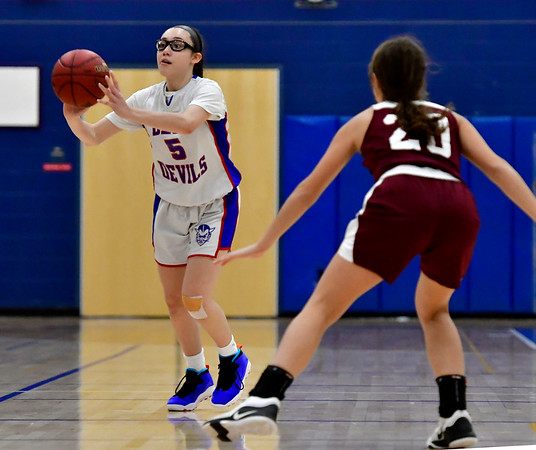12/13/2018 Mike Orazzi | Staff Plainville High School's Jaida Vasquez (5) during Thursday night's basketball game with Bristol Central at PHS.