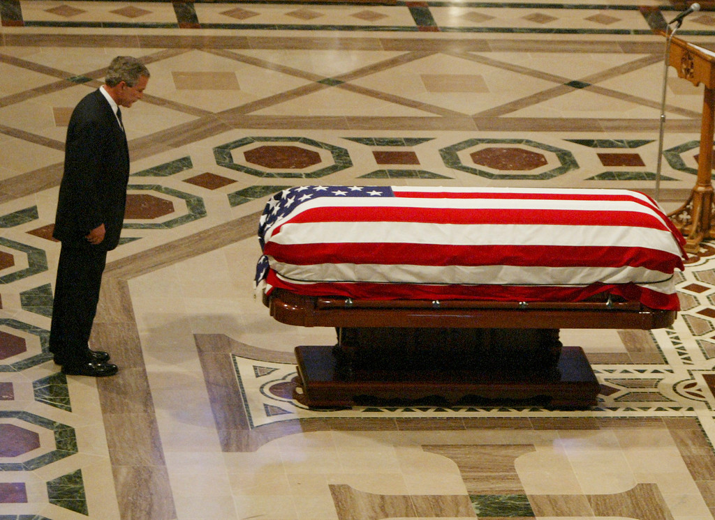 . President Bush pauses at the casket of former President Ronald Reagan after speaking during funeral services at the National Cathedral in Washington Friday, June 10, 2004. (AP Photo/)