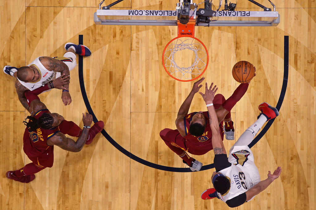 . Cleveland Cavaliers guard Dwyane Wade (9) drives to the basket past New Orleans Pelicans forward Anthony Davis (23) in the second half of an NBA basketball game in New Orleans, Saturday, Oct. 28, 2017. The Pelicans won 123-101. (AP Photo/Gerald Herbert)