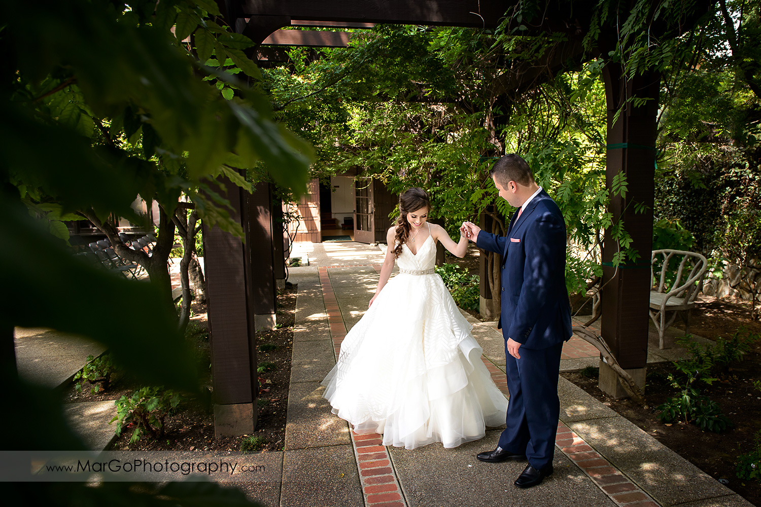 groom admiring bride during first look at Saratoga Foothill Club