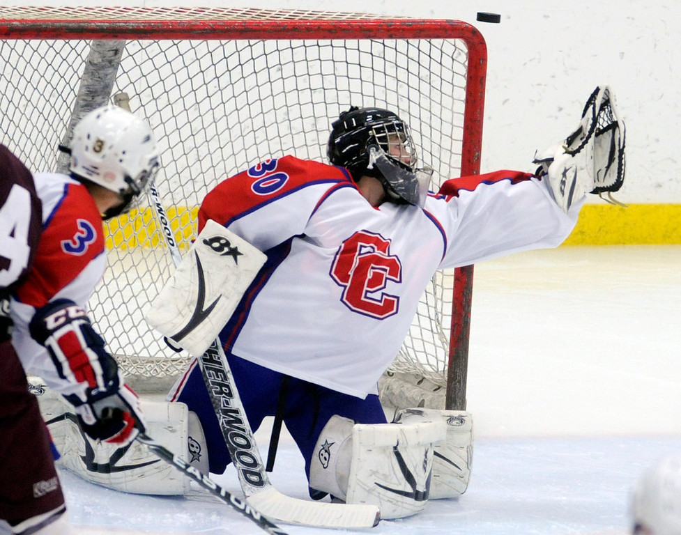 . Cherry Creek goal keeper Carson Pavek reaches for a save during the second period of play against Cheyenne Mountain  in 5A High School Hockey action at Family Sports Center in Englewood, CO Saturday December 8, 2012. (Photo by Evan Semon, Special to The Denver Post)