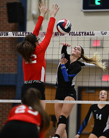 11/7/2019 Mike Orazzi | StaffrBristol Eastern's Ryley Plourde (11) and Conard High School's Avery Theriault (42) during the CCC girls volleyball tournament at Avon High School on Thursday. r