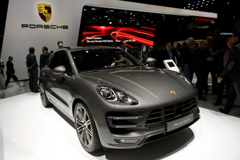 Description of . The new  Porsche Macan  is on display during the press day at the 84.  Geneva International Motor Show in Geneva, Switzerland, Tuesday, March 4, 2014.  (AP Photo/Keystone,Martial Trezzini)