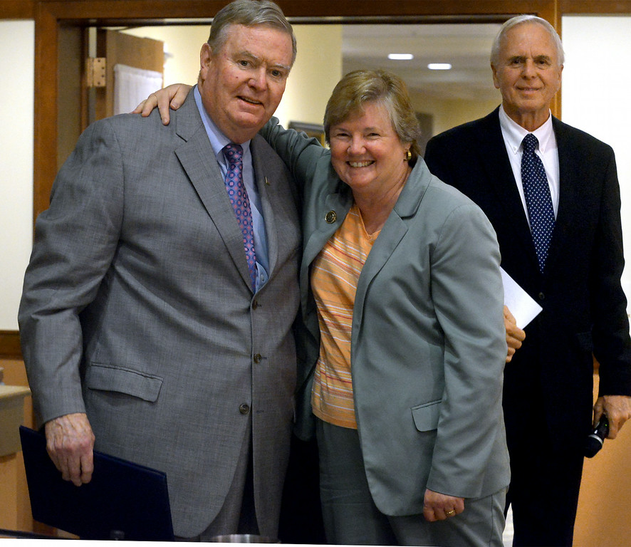 . Lower Gwynedd Township Supervisor Ed Brandt receives a proclamation and a hug from  Pa. State Representative Kate Harper, who formerly served on the board with Brandt. State Senator Stewart Greenleaf, right, waits to present a proclamation from the Senate during a board of supervisors meeting held at Foulkeways Tuesday, Aug. 25, 2014. Montgomery Media staff photo by Bob Raines