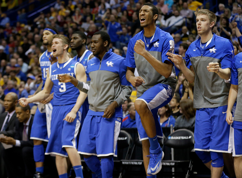 . Kentucky reaches against Wichita State during the second half of a third-round game of the NCAA college basketball tournament Sunday, March 23, 2014, in St. Louis. (AP Photo/Charlie Riedel)