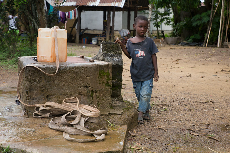 Monrovia, Liberia October 8, 2017 - A young boy stands near a community's water well.