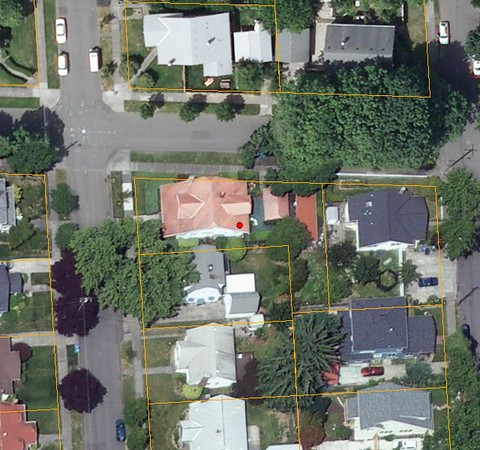 The house with the red roof and dot is our house/lot