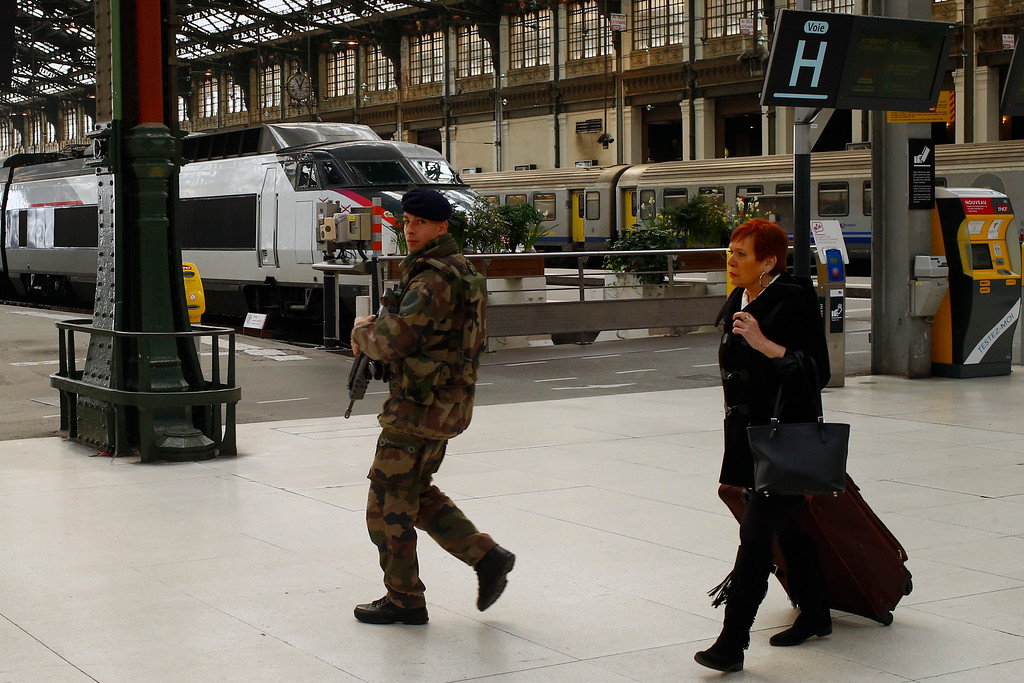 . French soldier patrols in Gare De Lyon railway station in Paris, France, Tuesday, March 22, 2016. Authorities are tightening security at airports and on the streets of European cities after attacks on the Brussels airport and subways system that killed at least one person and injured many others. (AP Photo/Francois Mori)