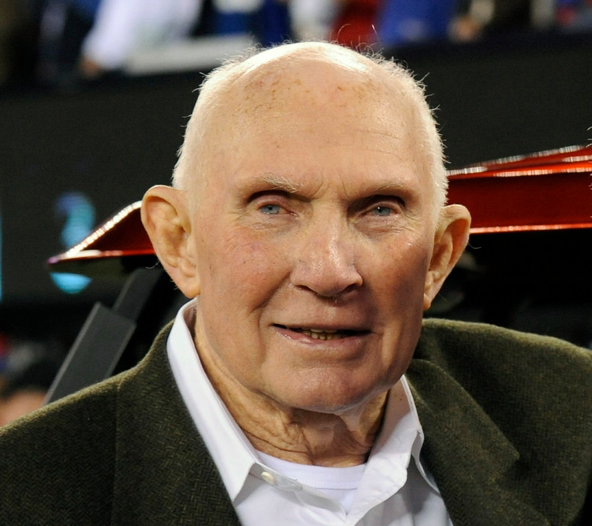 . FILE - In this Oct. 3, 2010, file photo, Y. A. Tittle poses before an NFL football game between the Chicago Bears and the New York Giants in East Rutherford, N.J. Tittle, the Hall of Fame quarterback and 1963 NFL Most Valuable Player, died Oct. 8. He was 90. His family confirmed to LSU, where Tittle starred in college, that he passed away. No details were immediately provided. (AP Photo/Bill Kostroun, File)
