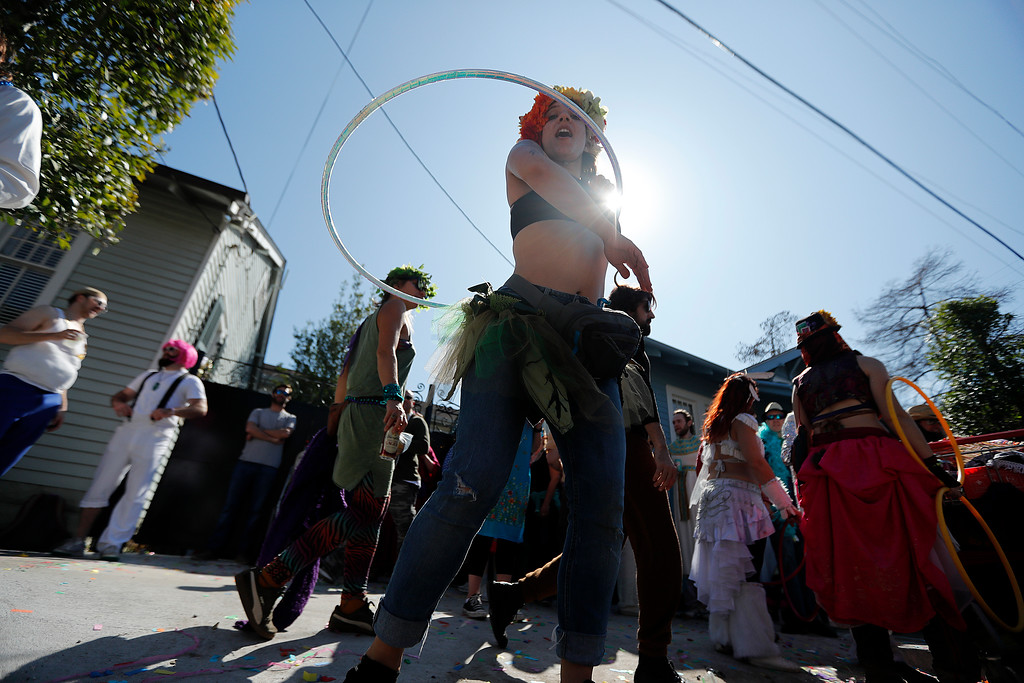 . A reveler twirls a hula hoop during the Society de Sainte Anne parade, on Mardi Gras day in New Orleans, Tuesday, Feb. 13, 2018. (AP Photo/Gerald Herbert)