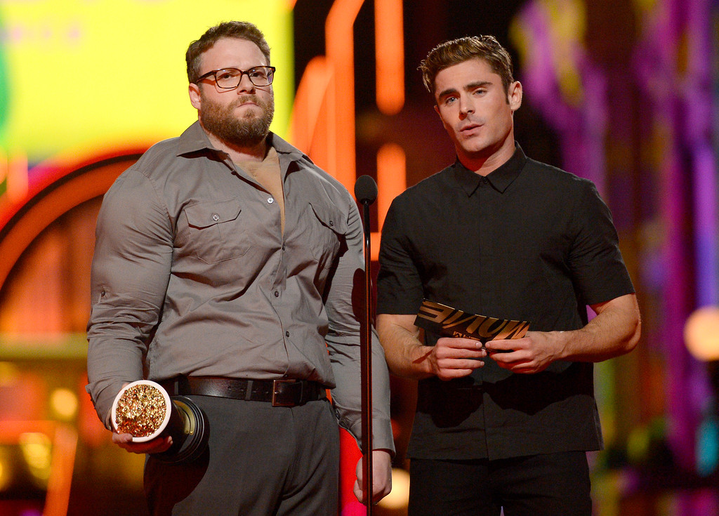 . Seth Rogen, left, and Zac Efron present the award for best comedic performance at the MTV Movie Awards at Warner Bros. Studio on Saturday, April 9, 2016, in Burbank, Calif. (Kevork Djansezian/Pool Photo via AP)