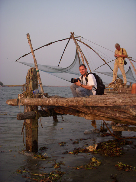 Jon Deutsch taking pictures of the sunset at the Chinese fishing nets in Fort Cochin