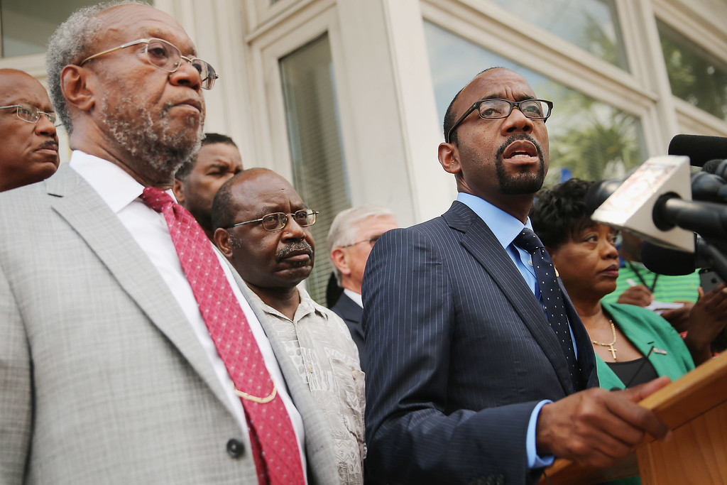 . NAACP National President & CEO Cornell Brooks (R) joins the Rev. Joseph Darby (L) and other local and state association leaders for a news conference about the shooting at the historic Emanuel African Methodist Episcopal Church outside the local branch offices June 19, 2015 in Charleston, South Carolina. Authorities arrested Dylann Storm Roof, 21, of Lexington, South Carolina, after he allegedly attended a prayer meeting at the church for an hour before opening fire and killing three men and six women. Among the dead is the Rev. Clementa Pinckney, a state senator and a pastor at the church, the oldest black congregation in America south of Baltimore, according to the National Park Service.  (Photo by Chip Somodevilla/Getty Images)