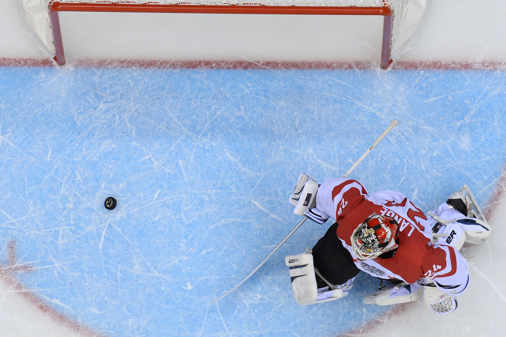 . Austria\'s goalkeeper Mathias Lange fails to stop a 2nd goal during the Men\'s Ice Hockey Play-offs Solovenia vs Austria at the Bolshoy Ice Dome during the Sochi Winter Olympics on February 18, 2014.  (ALEXANDER NEMENOV/AFP/Getty Images)