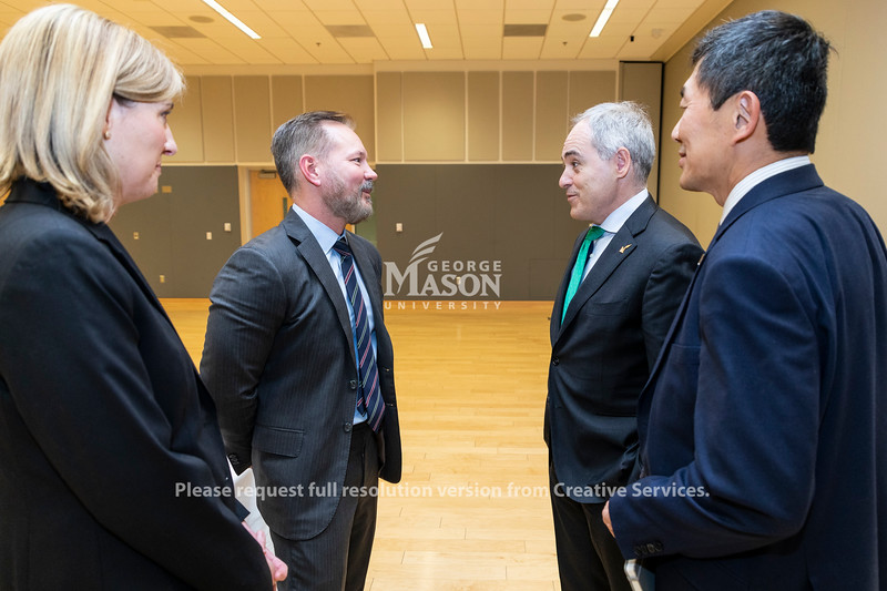 Holly Sullivan and Brian Huseman, of Amazon, talk with George Mason University president Ángel Cabrera and provost S. David Wu following a discussion about Amazon held by the Metropolitan Washington Council of Governments at George Mason University. Photo by Lathan Goumas/Strategic Communications