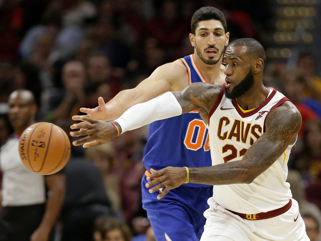 . Cleveland Cavaliers\' LeBron James (23) passes against New York Knicks\' Enes Kanter (00) in the second half of an NBA basketball game, Sunday, Oct. 29, 2017, in Cleveland. The Knicks won 114-95. (AP Photo/Tony Dejak)