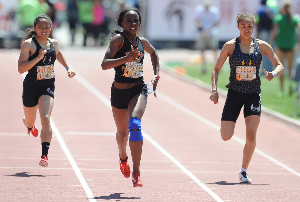 . Laura Anuakpado, center, of South Pasadena finished second in the 400 meter dash invitational high school during the Mt. SAC Relays in Hilmer Lodge Stadium on the campus of Mt. San Antonio College on Saturday, April 20, 2012 in Walnut, Calif.    (Keith Birmingham/Pasadena Star-News)