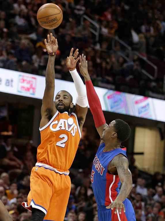 . Cleveland Cavaliers\' Kyrie Irving (2) shoots over Detroit Pistons\' Kentavious Caldwell-Pope (5) in the first half of an NBA basketball game, Tuesday, March 14, 2017, in Cleveland. (AP Photo/Tony Dejak)