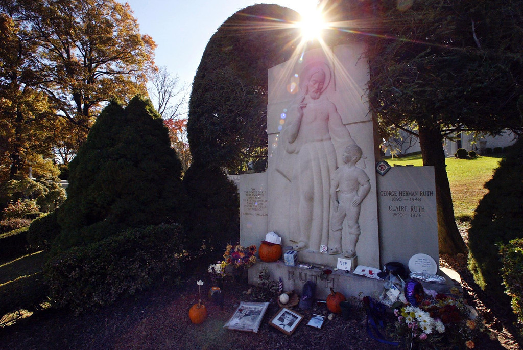 """. The grave of George Herman \'Babe\'\' Ruth is decorated with items left by New York Yankees and Boston Red Sox fans, Thursday, Oct. 28, 2004 in Hawthorne. The \""""Curse of the Bambino\"""" has followed Boston through four World Series defeats, each one in seven games. The end of the drought came Wednesday, Oct. 27, when Boston completed a sweep of the St. Louis Cardinals to win the World Series. (AP Photo/Mary Altaffer)"""