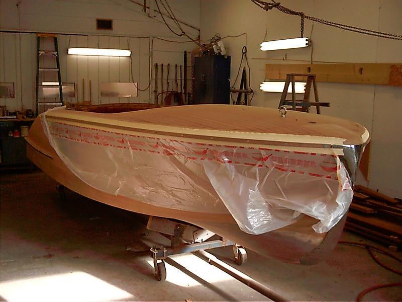 Starboard wood rub rail installed.