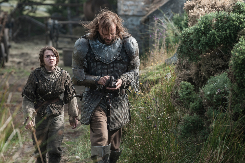 . Game of Thrones, Season 4: Maisie Williams and Rory McCann. (Photo by Helen Sloan)