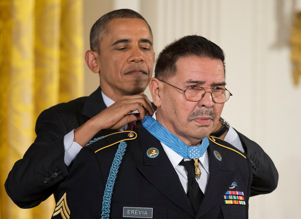 . President Barack Obama awards Army Spc. Santiago Erevia the Medal of Honor during a ceremony in the East Room  of the White House in Washington, Tuesday, March 18, 2014. President Obama awarded the Medals of Honor to 24 ethnic or minority U.S. soldiers who performed acts of bravery under fire in three of the nation\'s wars, that were denied because of prejudice.  (AP Photo/Manuel Balce Ceneta)
