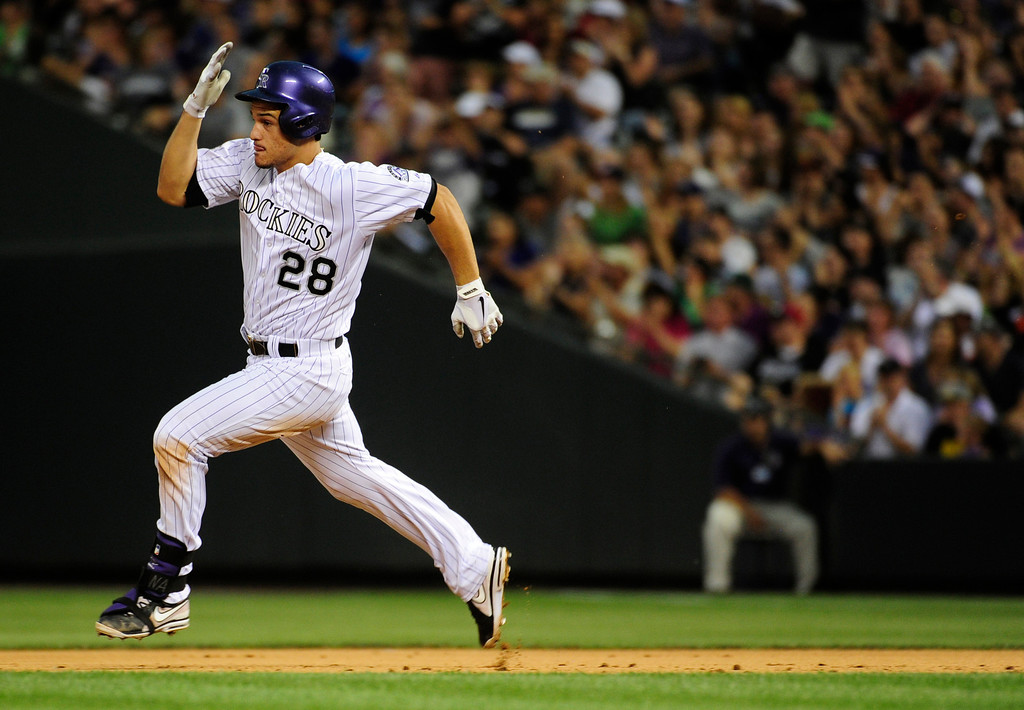 . DENVER - JUNE 28: Nolan Arenado of the Colorado Rockies runs to second base during the third inning of a baseball game against the San Francisco Giants on June 28, 2013 at Coors Field.  (Photo By Grant Hindsley / The Denver Post)
