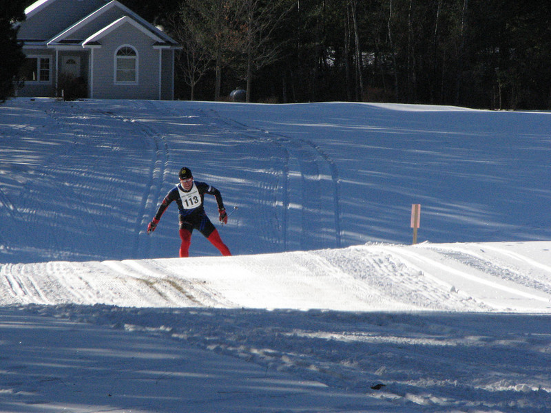 Milan Baic skis away from the competition early in the race and never looks back...