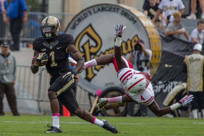 Akeem Hunt (1) runs for daylight as Mohammed Seisay (4) flies through the air during the fourth quarter of the Big Ten Conference game between the Purdue Boilermakers and the Nebraska Cornhuskers on October 12, 2013