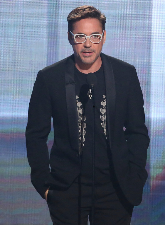 . Robert Downey Jr. presents the award of merit at the American Music Awards at the Microsoft Theater on Sunday, Nov. 20, 2016, in Los Angeles. (Photo by Matt Sayles/Invision/AP)