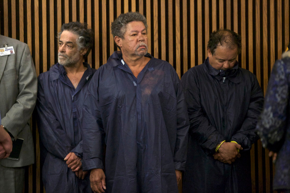 Description of . Ariel Castro (R), Pedro Castro (C) and Onil Castro appear in court in Cleveland, Ohio, May 9, 2013. Ariel Castro, 52, a veteran school bus driver fired from his job last fall, was formally charged with kidnapping and raping the three women, who were rescued from his house on May 6 evening shortly before his arrest.  REUTERS/John Gress