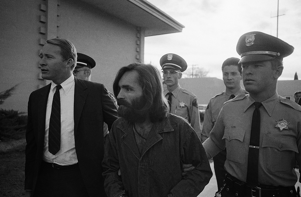Description of . Charles Manson, 34, arrives in court, on Dec. 3, 1969 for a preliminary hearing on a charge of possessing stolen property. Manson was arrested with 22 others in a desert commune near Death Valley. (AP Photo/Harold Filan)