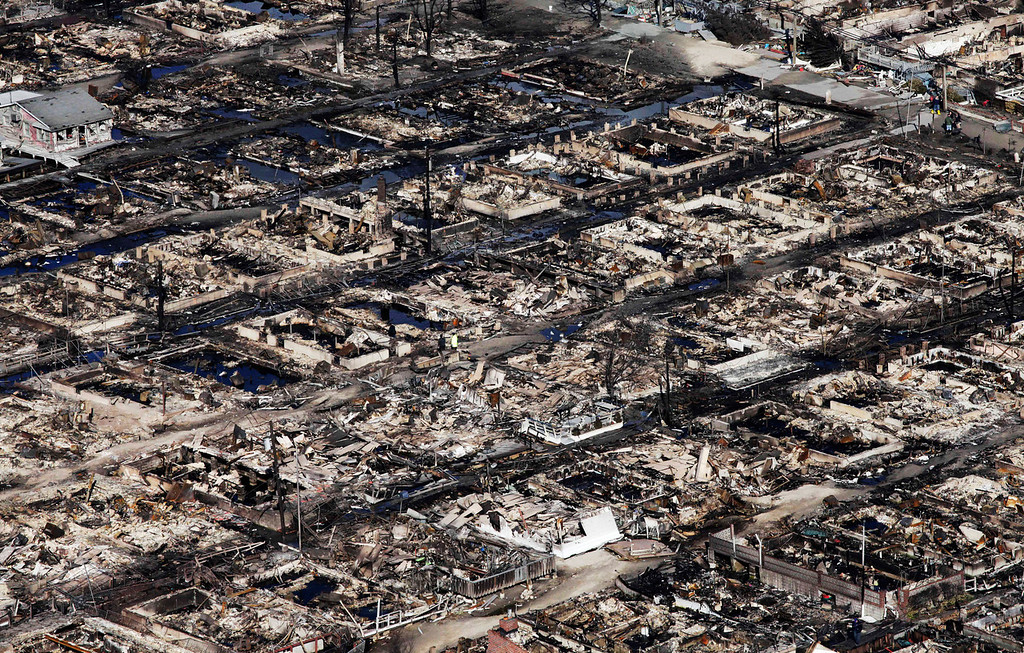 . This aerial photo shows the Breezy Point neighborhood, in New York, Wednesday, Oct. 31, 2012, where more than 50 homes were burned to the ground Monday night as a result of superstorm Sandy.  Sandy, the storm that made landfall Monday, caused multiple fatalities, halted mass transit and cut power to more than 6 million homes and businesses. (AP Photo/Mark Lennihan)