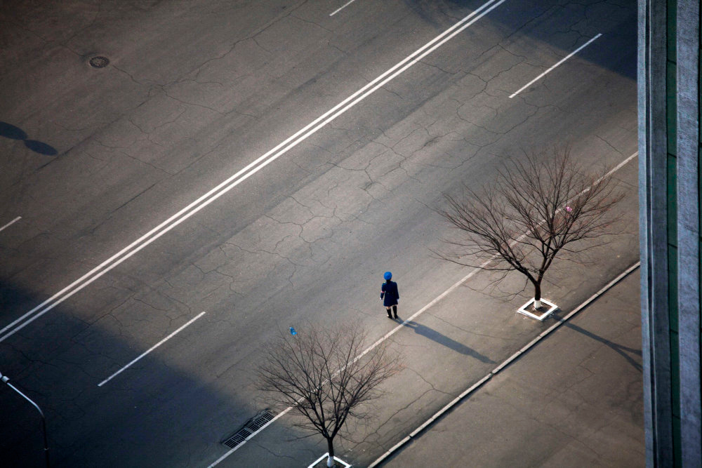 . A North Korean traffic police officer stands along a street in central Pyongyang, North Korea on April 13, 2011.  (AP Photo/David Guttenfelder)