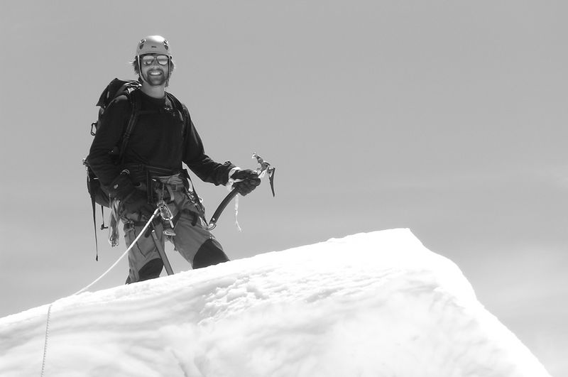 """Andrew on the top of the Hochstetter Dome. """"Triumphant!""""."""