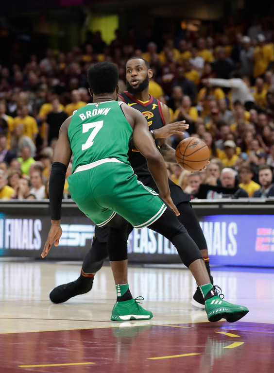 . Cleveland Cavaliers\' LeBron James, right, looks to pass as Boston Celtics\' Jaylen Brown (7) defends in the first half of Game 3 of the NBA basketball Eastern Conference finals, Saturday, May 19, 2018, in Cleveland. (AP Photo/Tony Dejak)