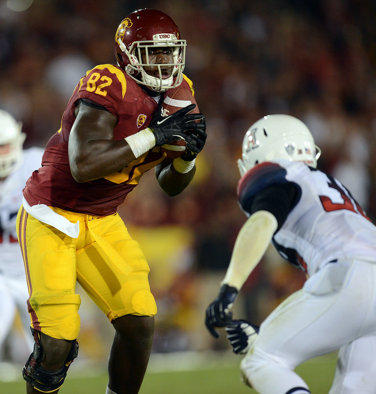 . USC\'s  Randall Telfer #82 hauls in a pass during their game against Arizona  at the Los Angeles Memorial Coliseum Thursday, October 10, 2013. USC defeated Arizona 38-31. (Photo by Hans Gutknecht/Los Angeles Daily News)