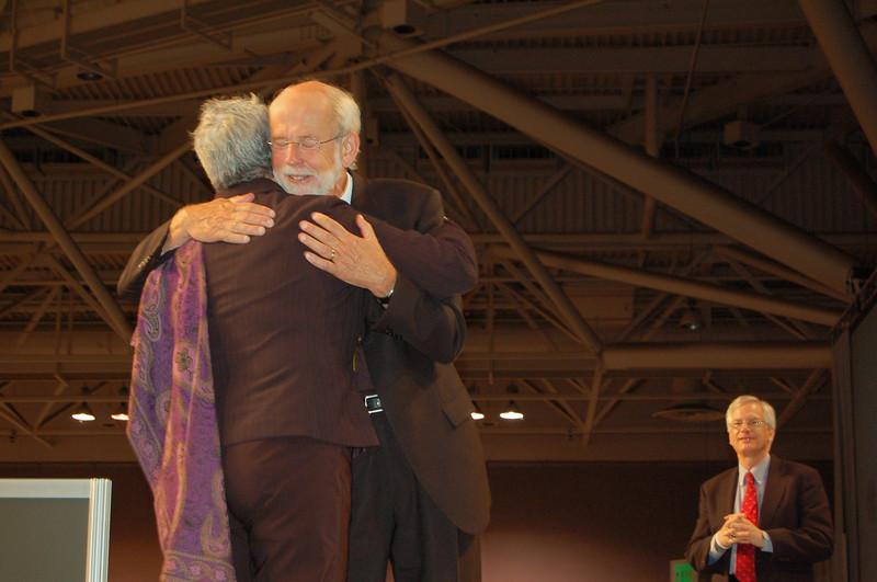 The Rev. Mark Hanson, presiding bishop, and the Rev. Susan Johnson, presiding bishop of the ELCIC, embrace after Johnson's greeting to the assembly.