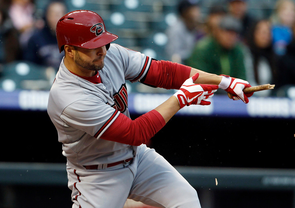 . Arizona Diamondbacks\' Cody Ross breaks his bat while popping out against the Colorado Rockies to end the top of the first inning of a baseball game in Denver, Saturday, April 20, 2013. (AP Photo/David Zalubowski)