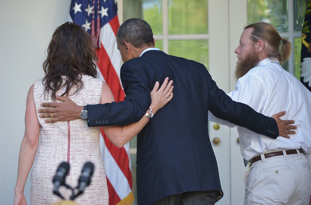 . US President Barack Obama and Bob and Jani Bergdahl, the parents of freed US soldier Bowe Bergdahl, return to the Oval Office after speaking in the Rose Garden of the White House on May 31, 2014 in Washington, DC. Obama spoke after the release of Bergdahl by the Taliban in Afghanistan.         (MANDEL NGAN/AFP/Getty Images)