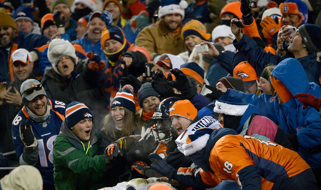 . Denver Broncos running back Montee Ball (28) in the stands with fans after scoring a fourth quarter touchdown. (Photo by Tim Rasmussen/The Denver Post)