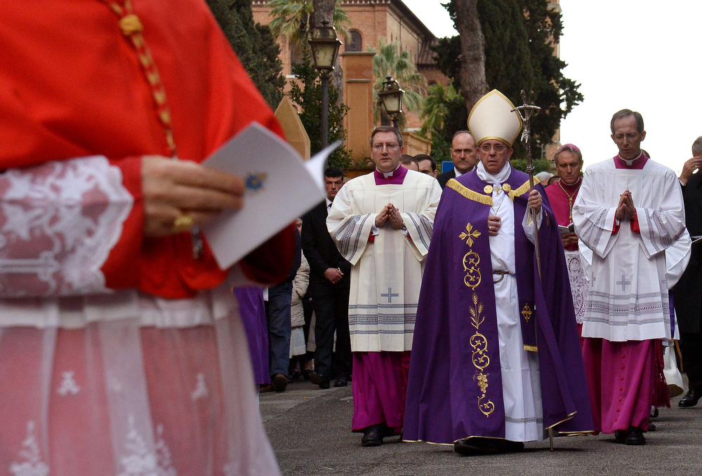 Description of . Pope Francis (C) walks during the procession to Santa Sabina church in Rome on March 5, 2014, prior to lead the mass for Ash Wednesday, opening Lent, the forty-day period of abstinence and deprivation for the Christians, before the Holy Week and Easter.  (ALBERTO PIZZOLI/AFP/Getty Images)