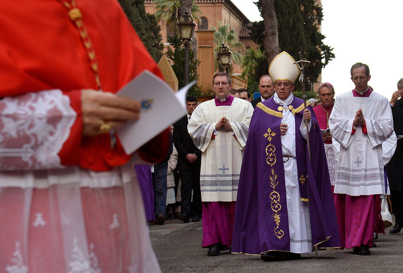 . Pope Francis (C) walks during the procession to Santa Sabina church in Rome on March 5, 2014, prior to lead the mass for Ash Wednesday, opening Lent, the forty-day period of abstinence and deprivation for the Christians, before the Holy Week and Easter.  (ALBERTO PIZZOLI/AFP/Getty Images)