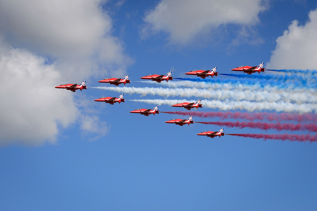 . The Red Arrows perform a flypast to formally open the Farnborough air show in Hampshire, England, on July 14, 2014.  The biennial event sees leading companies from the aviation industry showcase their latest technology.    AFP PHOTO/Leon NEAL/AFP/Getty Images